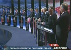 GOP candidates raising their hands to say they do not believe in evolution