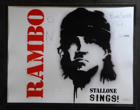 "PHOTO: Rambo poster modified to say ""Stallone Sings"""